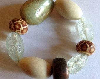 marbled cream and sage green plastic beaded bracelet retro design