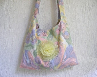 Pastel shoulder bag decorated with a yellow rose
