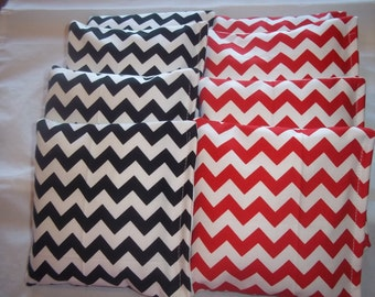 8 ACA Regulation Cornhole Bags - 4 Black and White & 4 Red and White Chevron Stripes