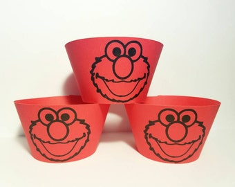 12 Elmo cupcake wrappers  c red cupcake wrappers these are Sesame Street inspired