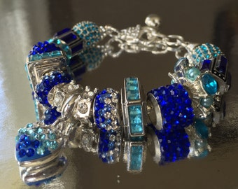 Crystal and blue bead bracelet.