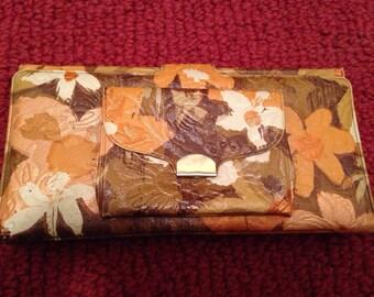 Brown, orange and gold vinyl wallet.