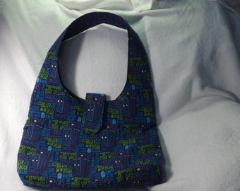 "Hobo purse bag made from Doctor Who ""Bigger on the inside"" Tardis cotton fabric with purple tonal fabric for the lining."