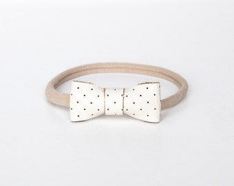 Mini leather bow nylon elastic one size fits all, tiny cream leather