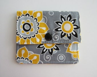 Compact Snap Wallet with card slots, and a pocket at the back for folded cash or receipts. Yellow, Grey, Black, Flowers