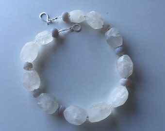 A Sense of Snow: frosted rock crystal, agate, sterling silver. Necklace and earring set.
