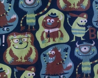 fitted crib sheet  / toddler fitted sheet made from fabric printed with cute monsters