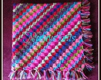 Corner-to-corner, tassle edged afghan blanket or throw. Custom orders also welcome