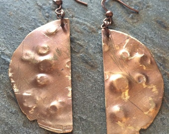 Hammered/textured copper drop earrings.