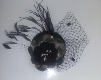 Black headdress with feathers & veil