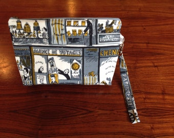 "Vintage ""French shops"" fabric wristlet"