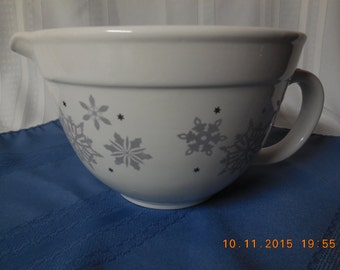 Ceramic mixing bowl with snow flakes on white in silver, very Christmasy.