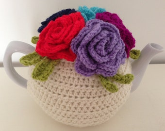 Multi-coloured spring inspired crocheted tea cosy