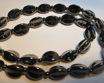 20 Vintage Three-Sided Metallic Glass Beads.