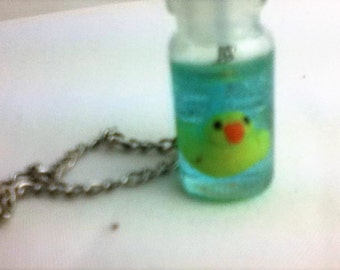 Rubber ducky in a bottle necklace