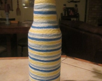 Upcycled Blue, Yellow and White Yarn Wrapped Beer Bottle