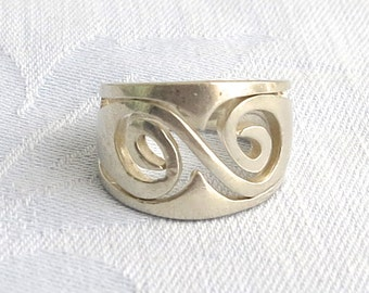 Sale Item - Wide sterling silver band ring with open metal work in the front and solid sterling silver at the back, stamped 925, size Q/ 8
