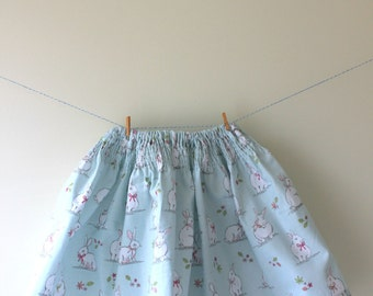 Bunny rabbit skirt, a sweet selection of bunny rabbits in bows on pale green with a fully elasticated and smocked waistband