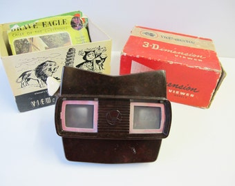 Vintage Bakelite View-master made by Sawyers in Belgium. Model E 1955-61. In original box with 9 reels including Bambi and Cinderella