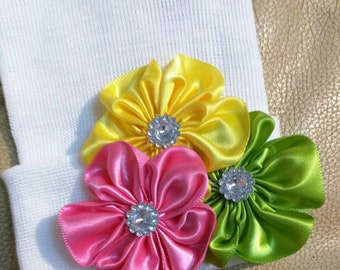 Newborn Hospital Hat w/ Green, Pink and Yellow Flower Applique and Rhinestones. Infant Hat. Choice of Hat Selection. Great Gift!