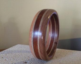 Handcrafted  Wood Bangle made from  Rose Gum(Eucalyptus), Mahogany and Tasmanian Blackwood (Australian )  Sculptor Colin Watson