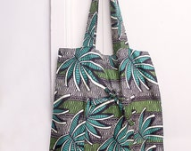 Shopping bag, reusable shopping bag, grocery bag or a tote bag, foldable pouch, with graphic pattern of exotic leaves