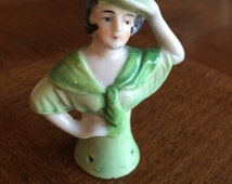 """Japan Green  Porcelain Half Doll with Black Hair and Green Hat, 3 1/4"""" tall"""
