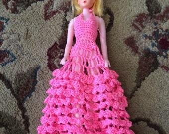 Vintage doll in pink dress