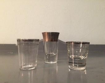 Three Mismatched Vintage Silver Rim Shot Glasses