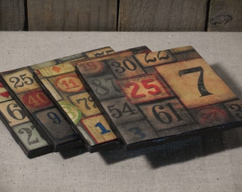 Tile coaster numbers print from vintage game pieces or signs; set of 4
