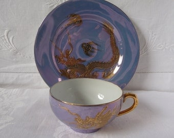 Smiling Geisha Lithophane Japanese WWII Eggshell Porcelain Dragon Cup and Plate Blue Lustre and Gold