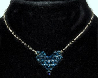 Chic 70's industrial sweetheart necklace: 925 sterling silver rolo, urban geometric heart pendant of blue Aurora Borealis AB crystal flowers