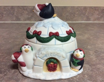 A Cute Decorated for Christmas Igloo  Candy Dish with Penguins on and around it, Figi's.