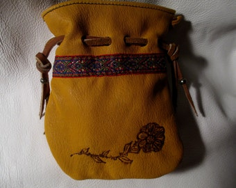 Hand made deer skin pouch with embroidery.