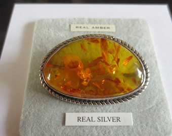 Silver and large amber