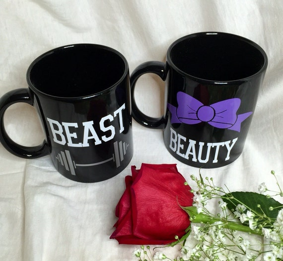Beauty and Beast Coffee Cups. Hers comes with a bow, his comes with a weight bar.