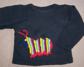 black toddler jumper with caterpillar pocket