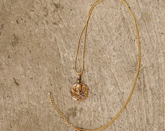 Sold...Antik watch movement necklace