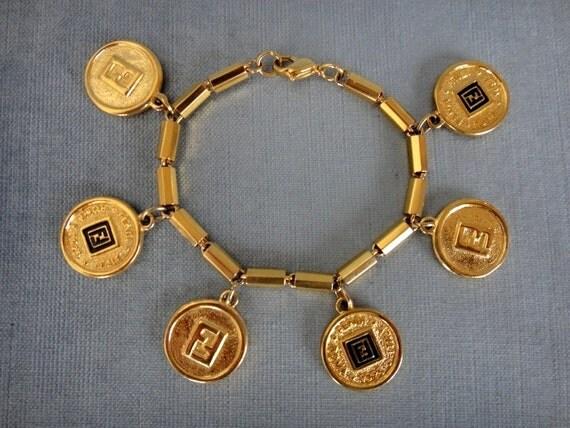 iconic fendi signed logo charm bracelet black enamel 18k