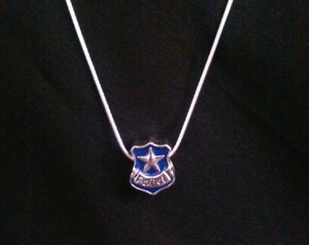 Police pendant with sterling silver necklace.