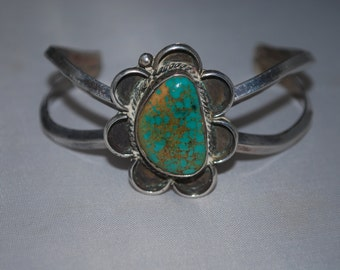 Sterling silver native american motif cuff bracelet with turquoise.