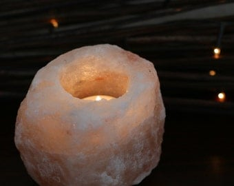 Stunning salt stone tea light candle holder. Great healing qualities and would meake a perfect gift.