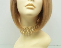 Short Lace Front Heat Resistant Wig with Butterscotch Blonde Color and Dark Roots. [39-221-Sofi-T1B/BS]