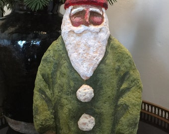Green and red santa with snowballs