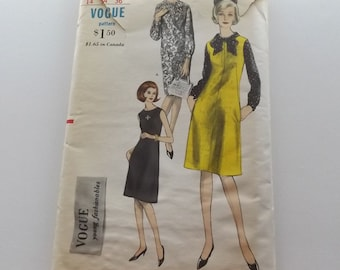 Vogue 6166 sewing pattern,  Dress, jumper, and blouse,  A-line with pockets.  Uncut, size 14