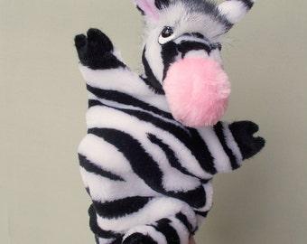 Zebra. Bibabo. Toy on hand. Puppet. Toy glove. Marionette. Puppet theatre.