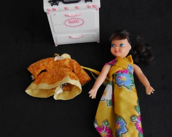Mattel Tutti Barbie Doll, Brunette, Blue Eyes with Rare Pink & White Stove, Spare Orange and Yellow Floral Dress, 1965 Barbie Collectible