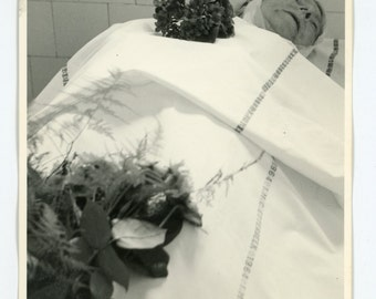 Lady in the morgue - post mortem photo of an elderly woman- death, funeral, mourning
