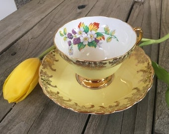 Beautiful Rosina gold and creamy yellow vintage teacup and saucer