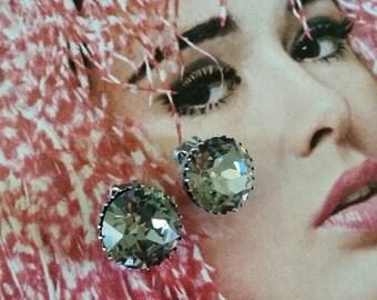 Vintage signed Austria Smokey Grey rhinestone clip earrings.